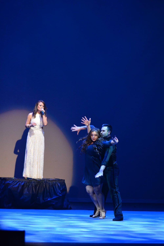 Atanas Malamov dances at a singers performance