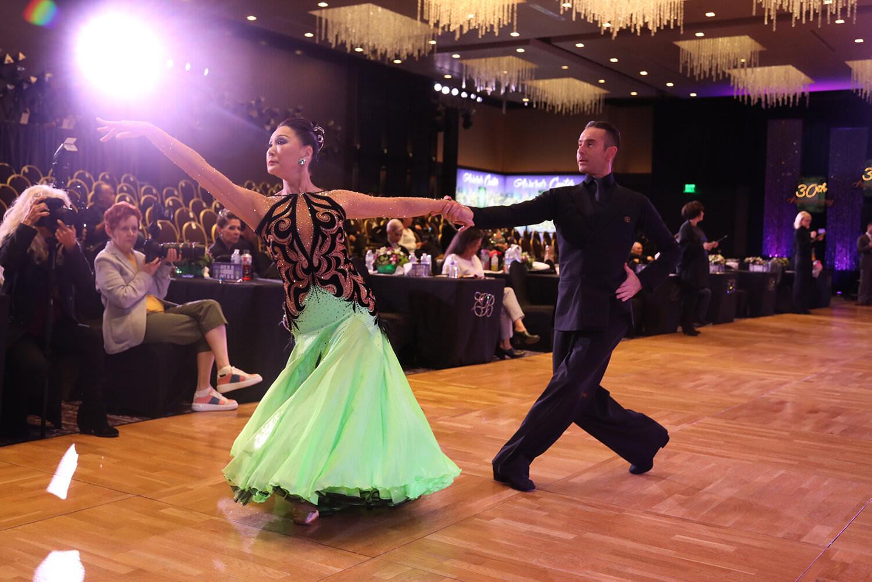 a picutre of atanas malamov and a student dancing at Emerald Ball