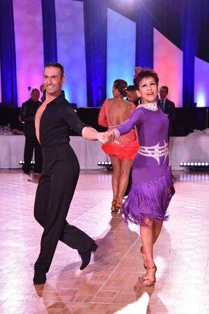Atanas and Pro-am student Rumi dance Cha- cha at Embassy Ball