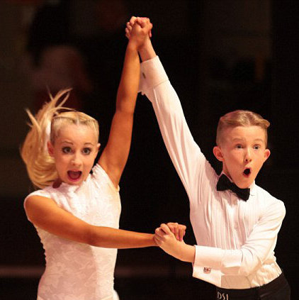 a picture of cute kids dancing the jive