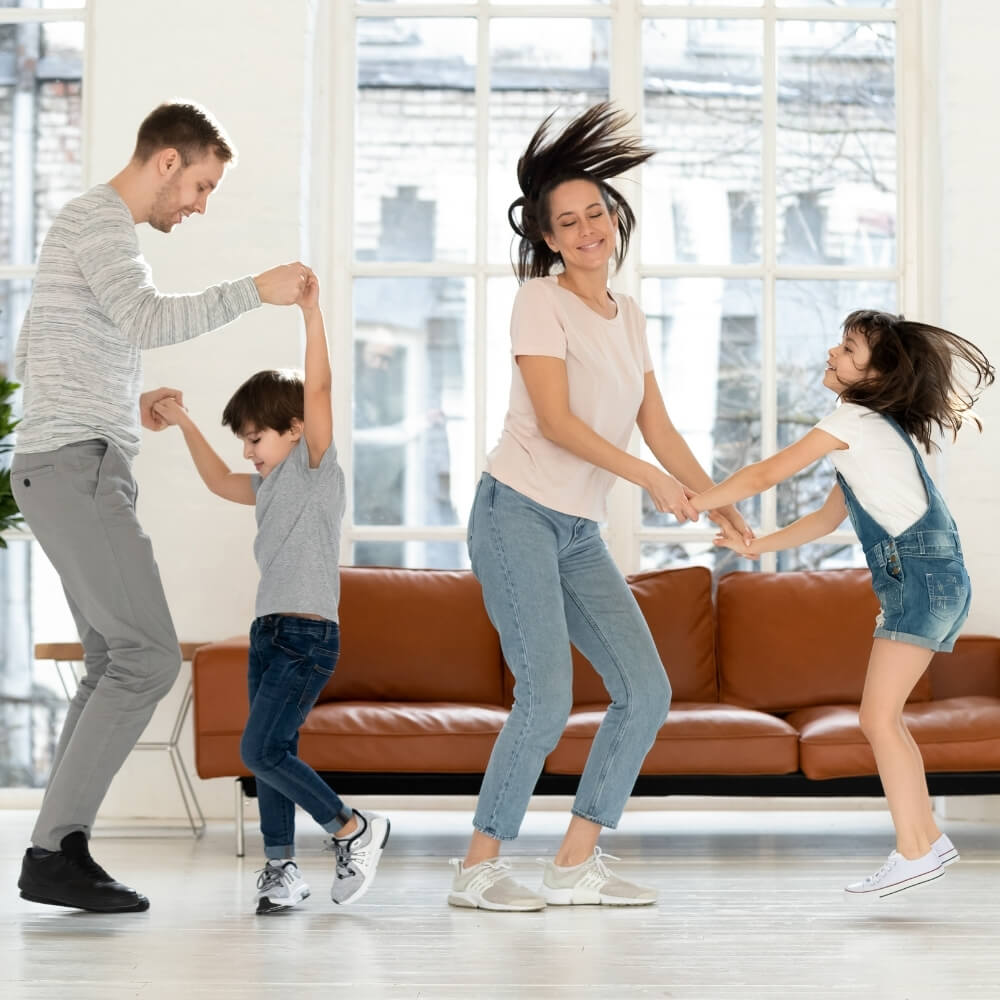a picture of a happy family dancing together
