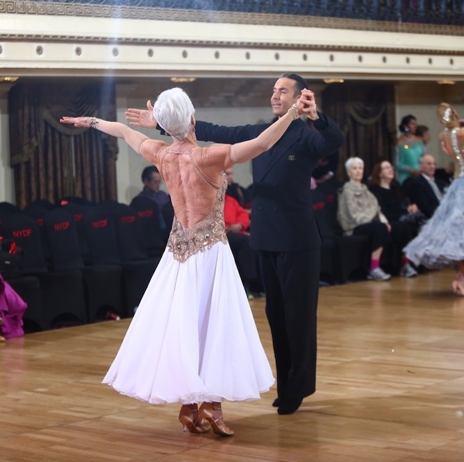 A picture of pro-am dance couple dancing the waltz