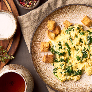 Rustic scrambled eggs with croutons