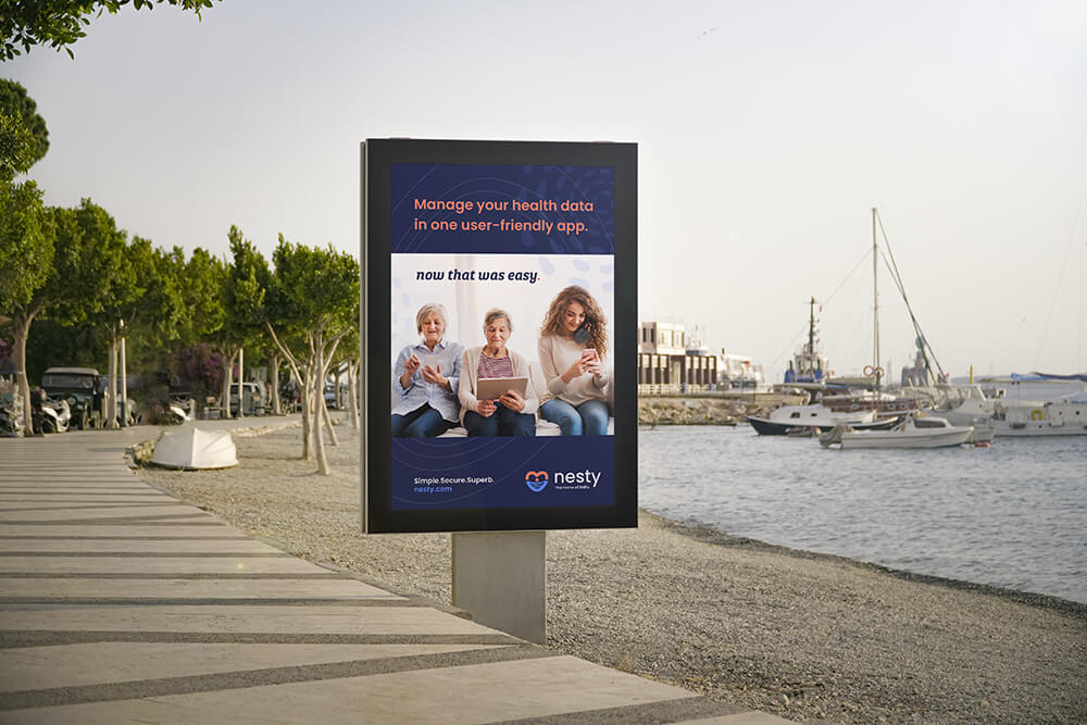 Harbor boardwalk with a digital poster advertisement for Nesty, the EMR software and mobile app