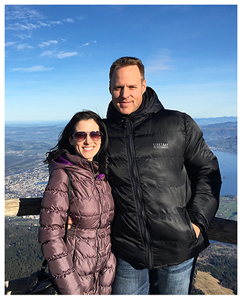 Holly Greiff and her husband in Switzerland with mountain view