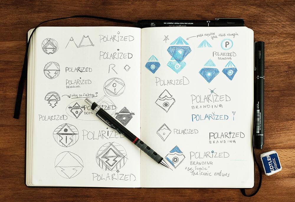 Notebook illustration of logo sketches for Polarized Branding