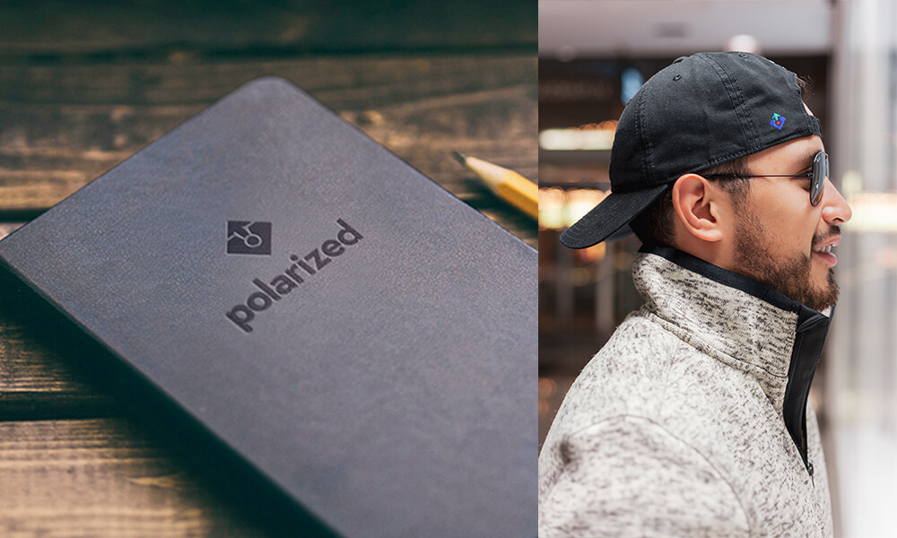 Black notebook with embossed Polarized Branding logo and a man wearing a backwards baseball cap with Polarized Branding logo