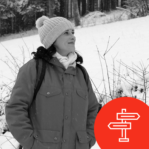 Holly Greiff walking in the snow in Germany wearing a winter beanie and Fjallraven jacket