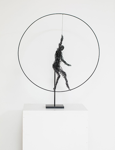 Sculpture by Belgian artist Anne De Mol. Her techniques are varied, combining the strength of bronze, lightweight plaster and strings. In her works, the human remains at the center of its concerns, especially women, harboring sensuality, strength but also fragility. Balanced on top of sprawling socles, tangled in inextricable network of strings coated with plaster, movements or contemplative to the wide world around them, her bronze sculpted figures are invitations to jump in with both feet in the intoxicating world of Anne De Mol. An ode to life!