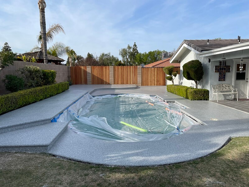 Pool covered while resurfacing of concrete