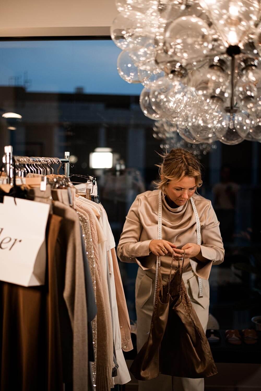 Sarah Nordström standing by a clothes rack