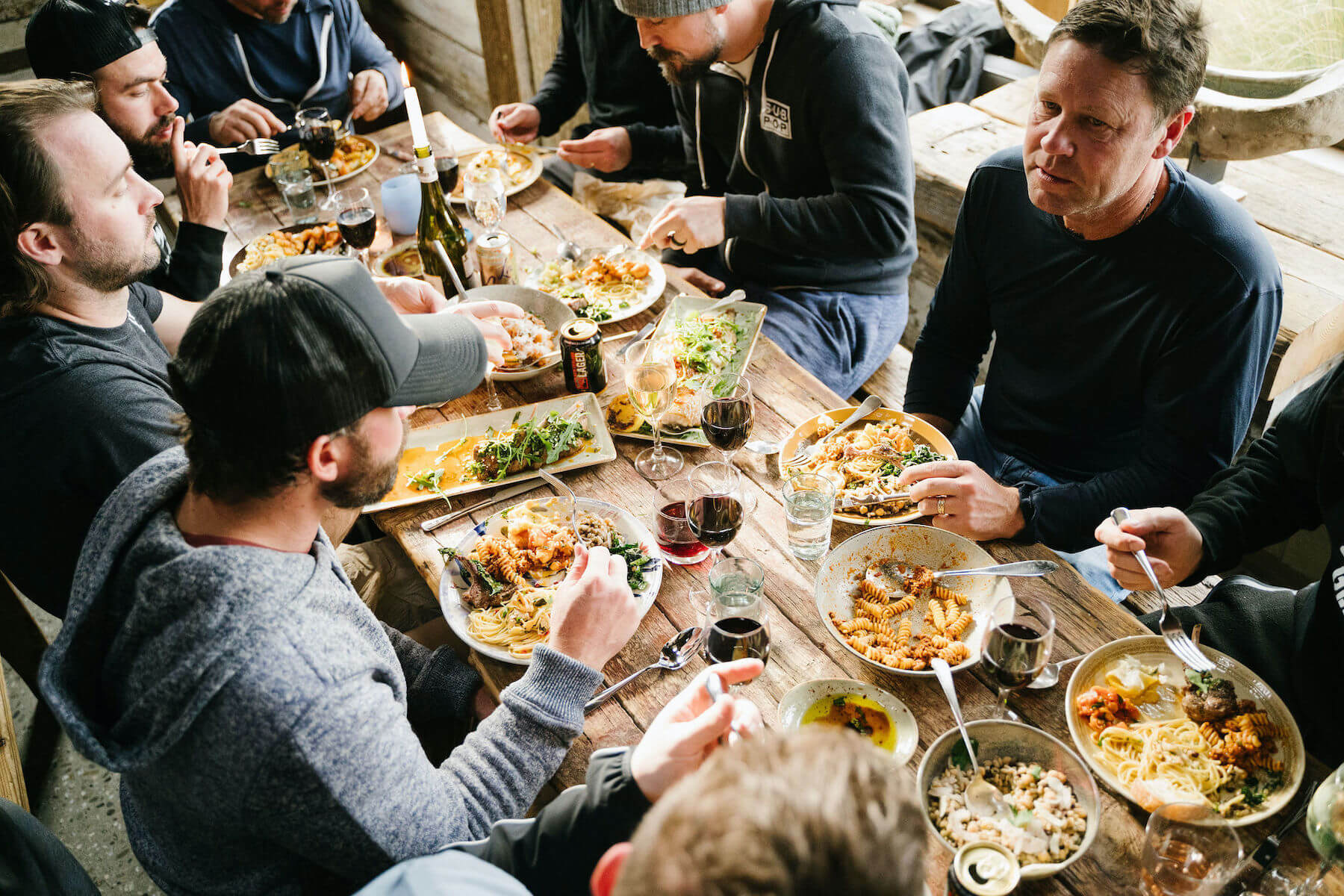 People gathering around a table for food
