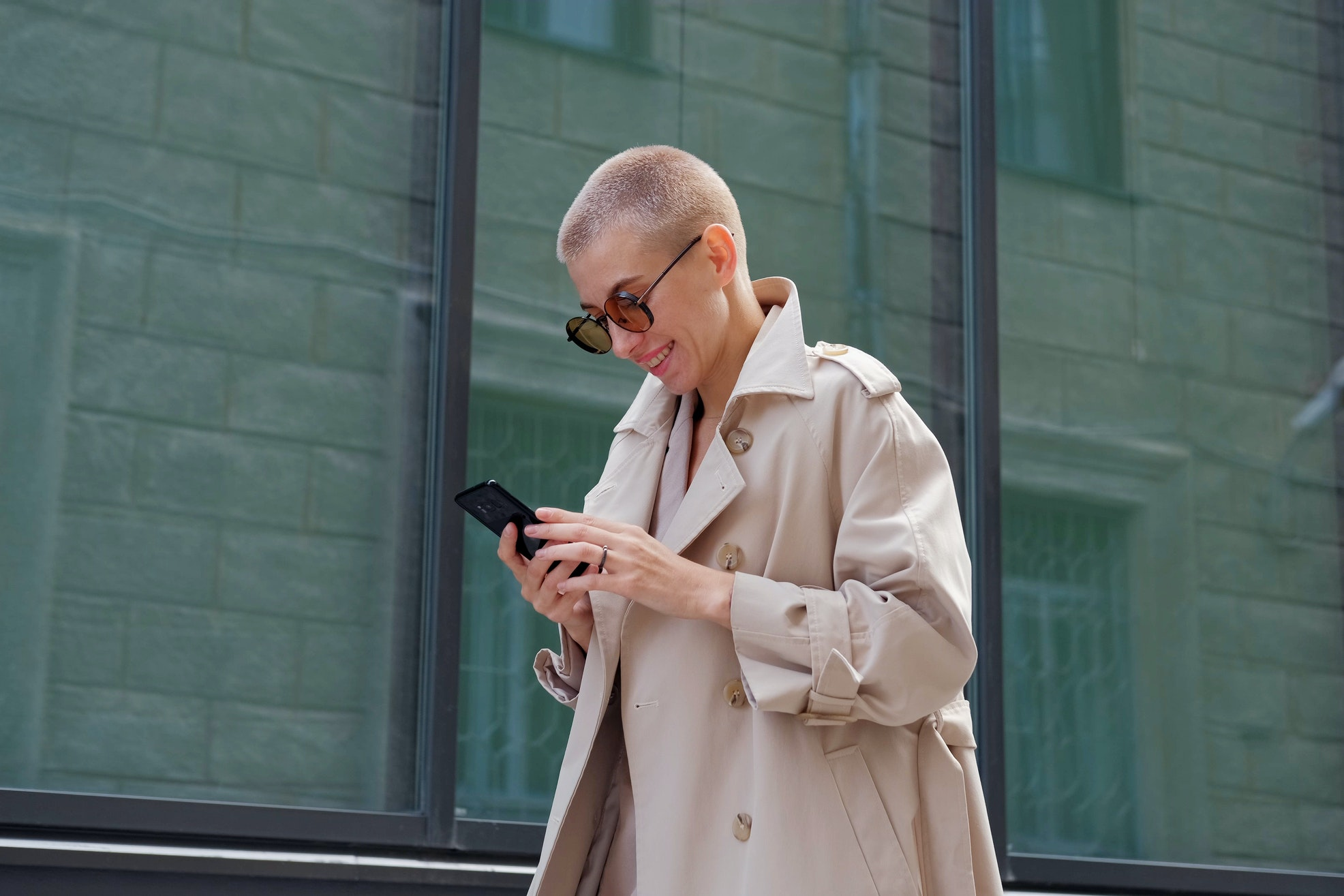 woman looking at types of content on her phone while walking