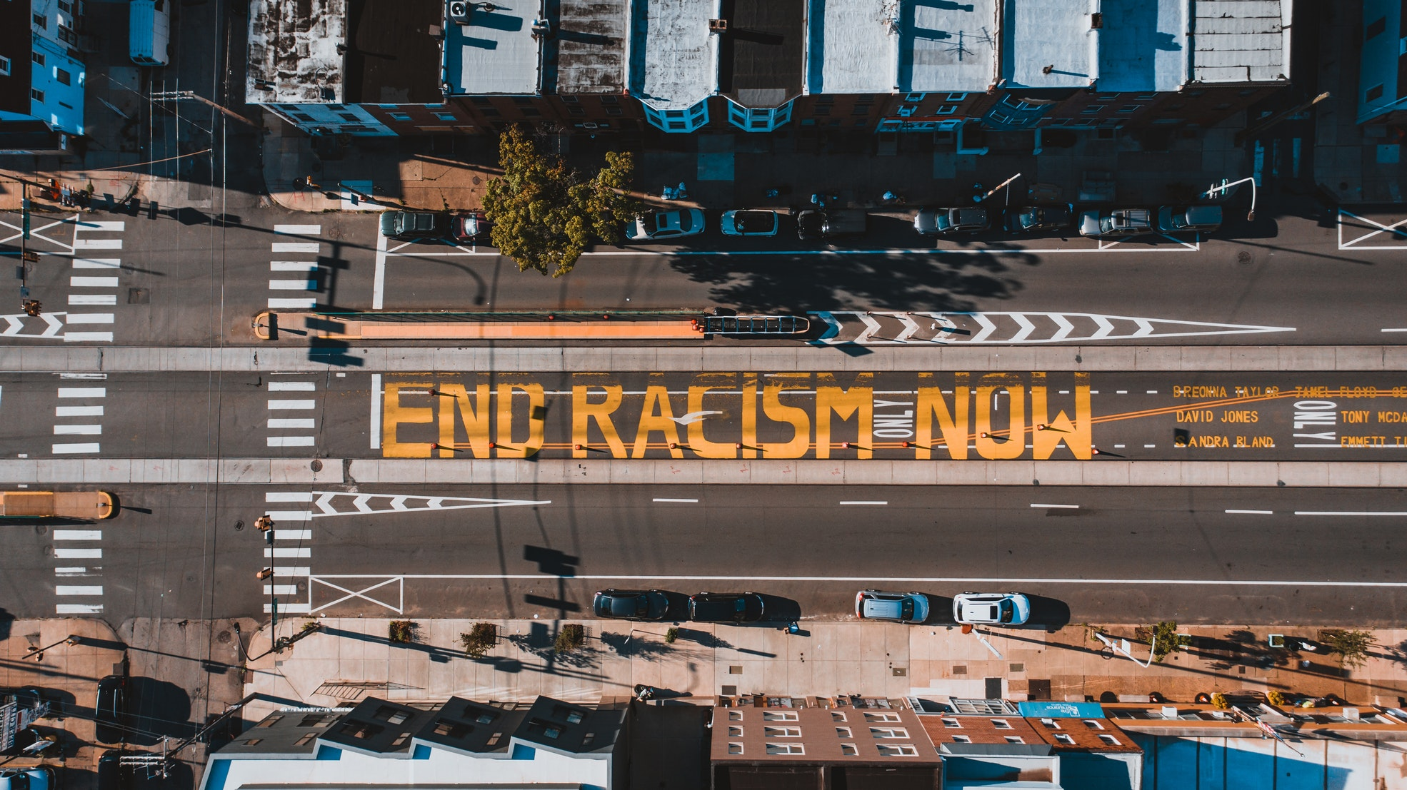 bird's eye shot of social justice in business text on road saying end racism now