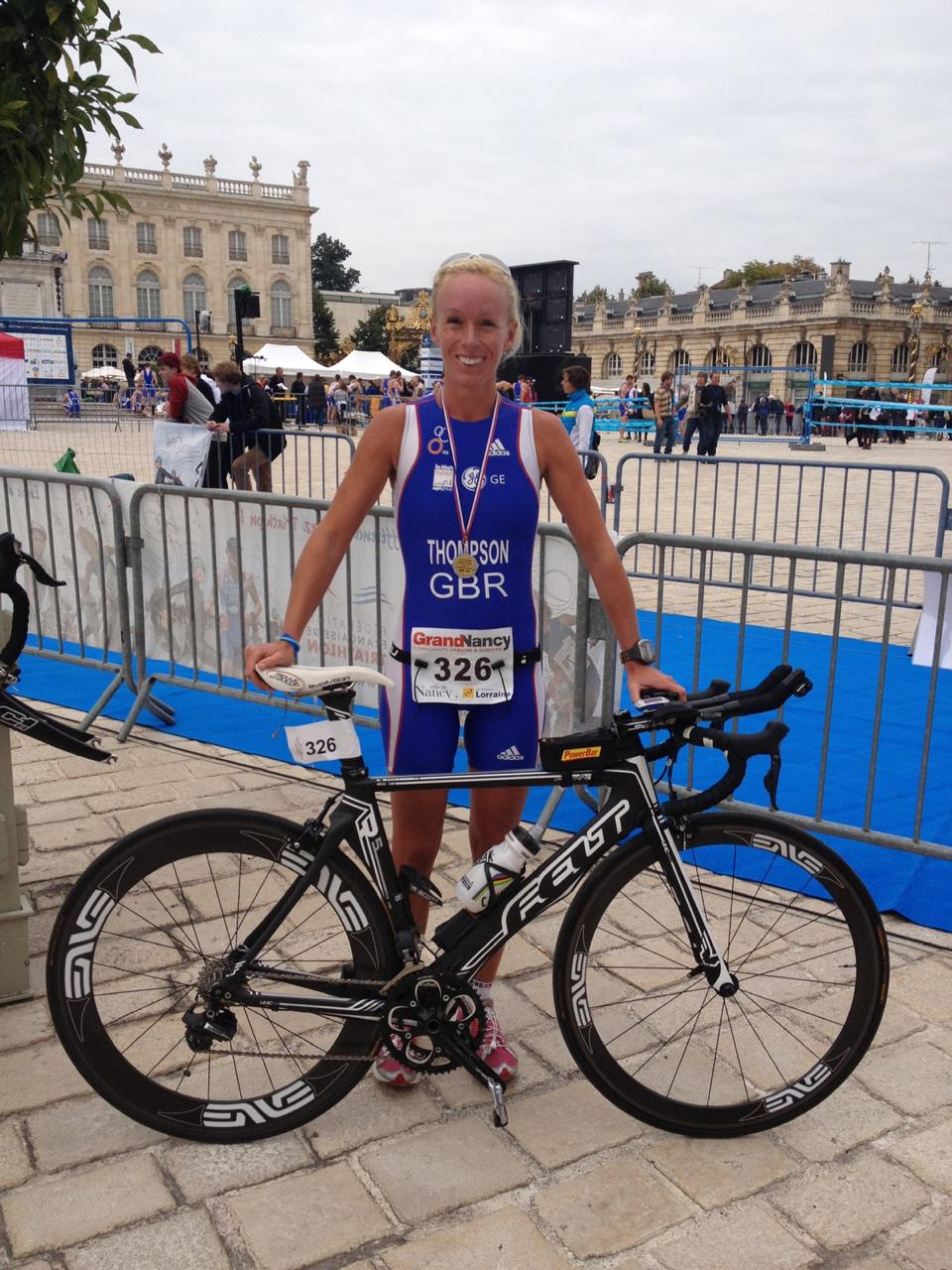 Katie with bike in GB kit