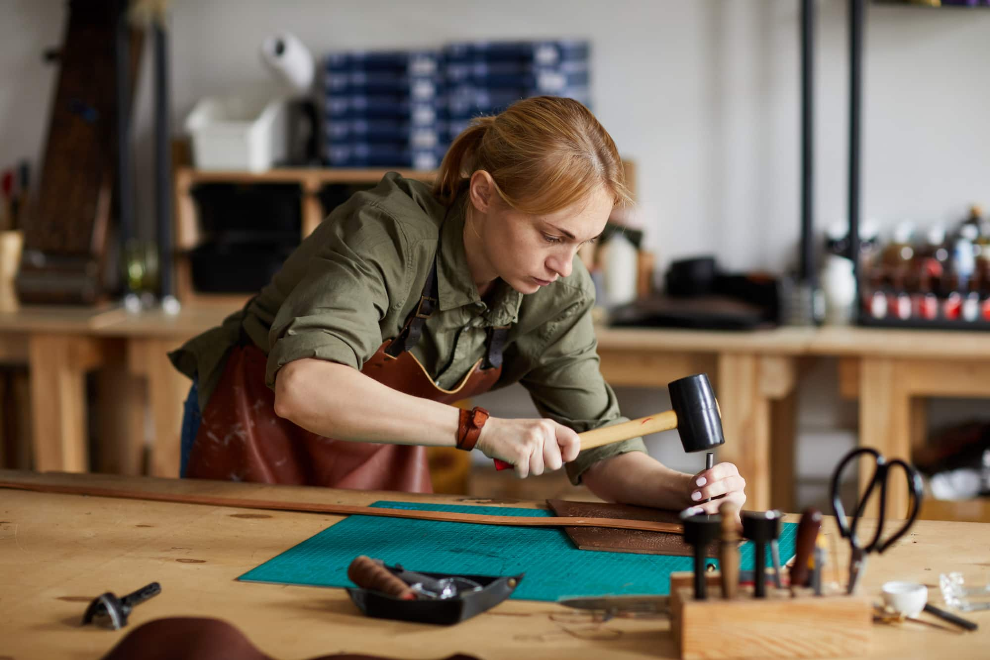 An image of a craft person at work to demonstrate how a large image can be greatly reduced in file size.