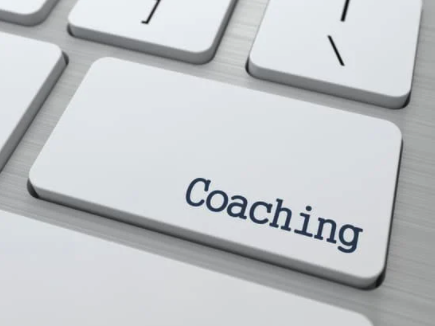 Image of keyboard button labeled coaching