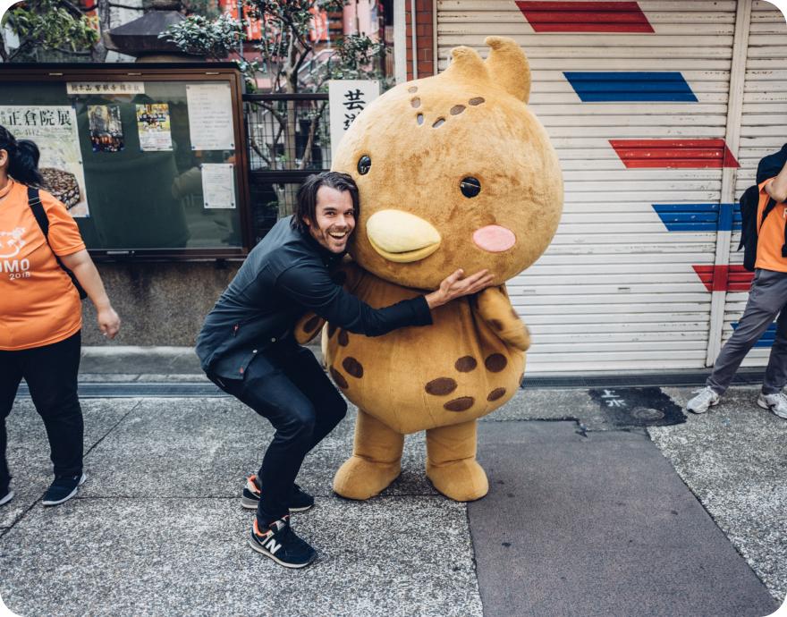 Nate Kadlac hugging a stuffed animal