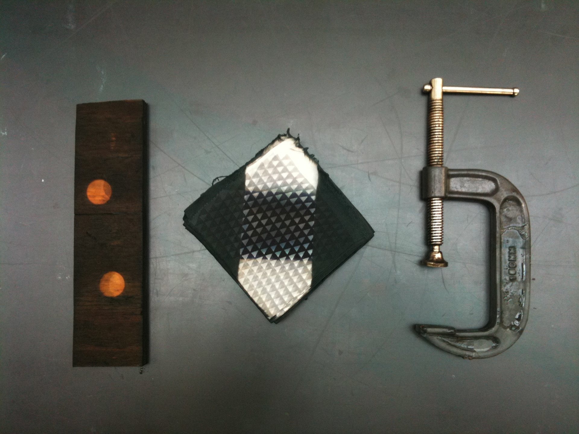 tools and folded shibori fabric