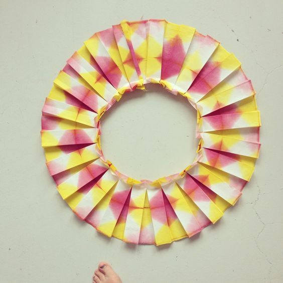 A pink and yellow piece of fabric folded in a circle