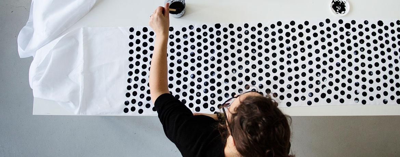 textile arttist elsa chartin printing a fabric by hand