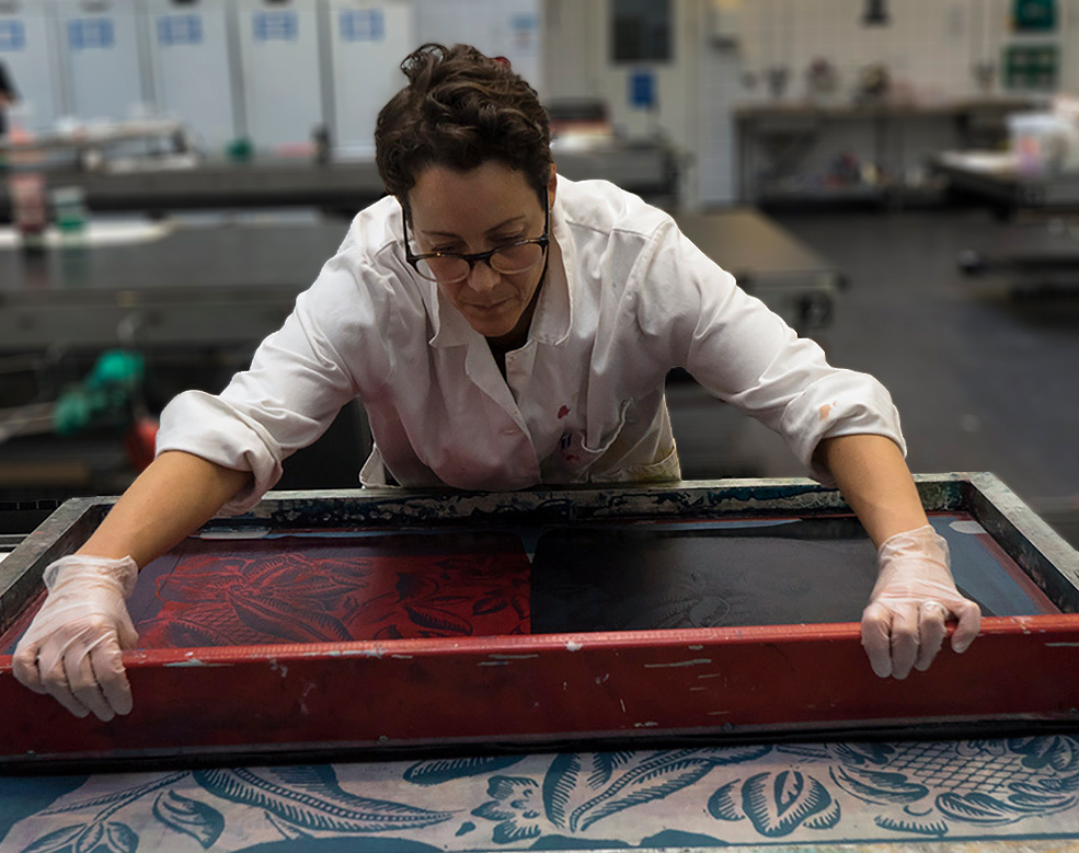 Artist Elsa Chartin printing fabrics in her workshop