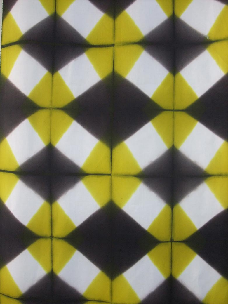 A black and yellow shibori fabric by Elsa Chartin