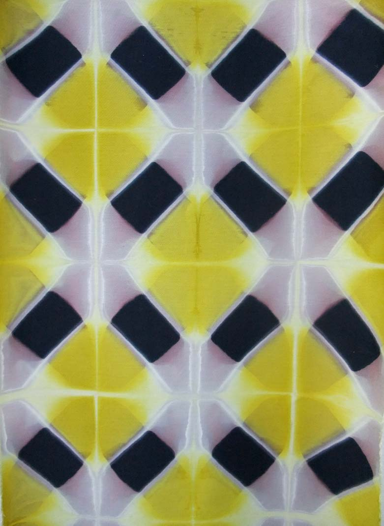 a pink and yellow shibori dye