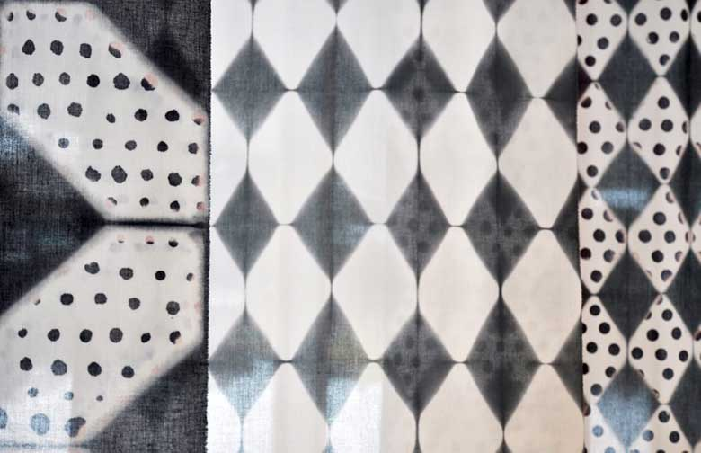 three black and white fabrics with shibori dye