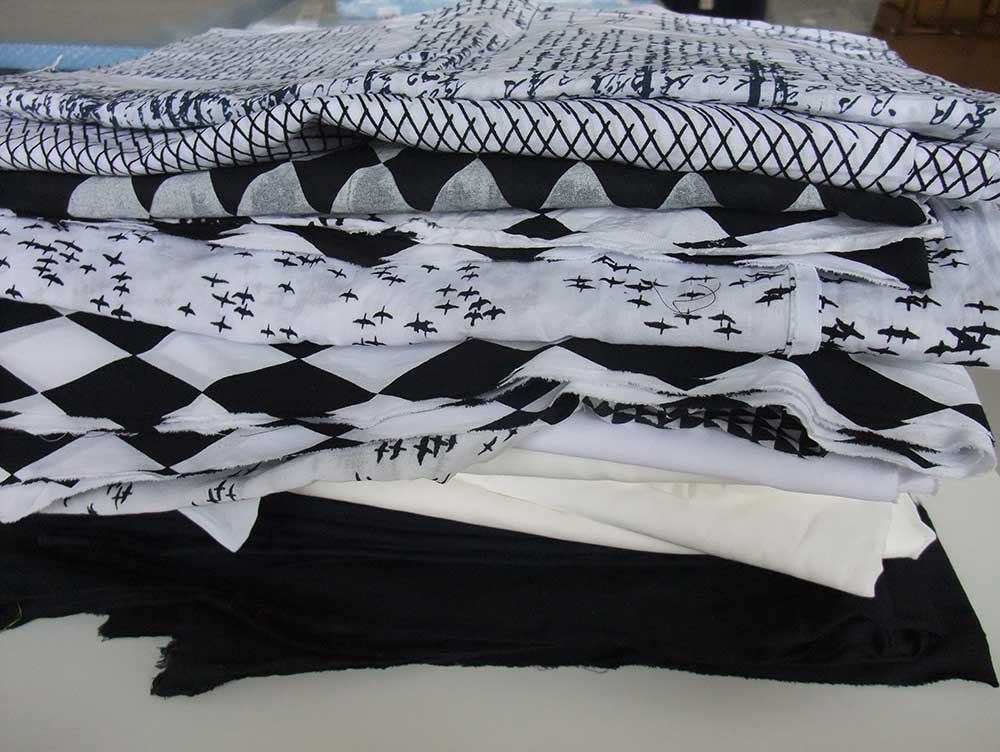 A stack of black and white fabrics