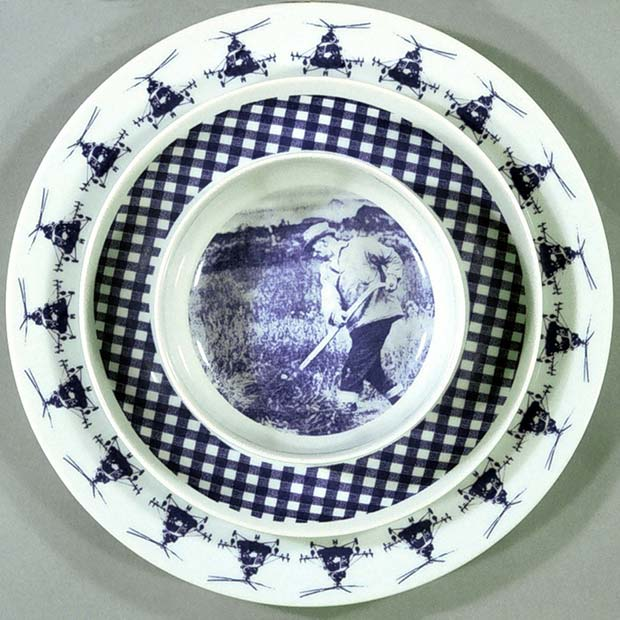 Plates designed by Elsa Chartin featuring a farmer and helicopters