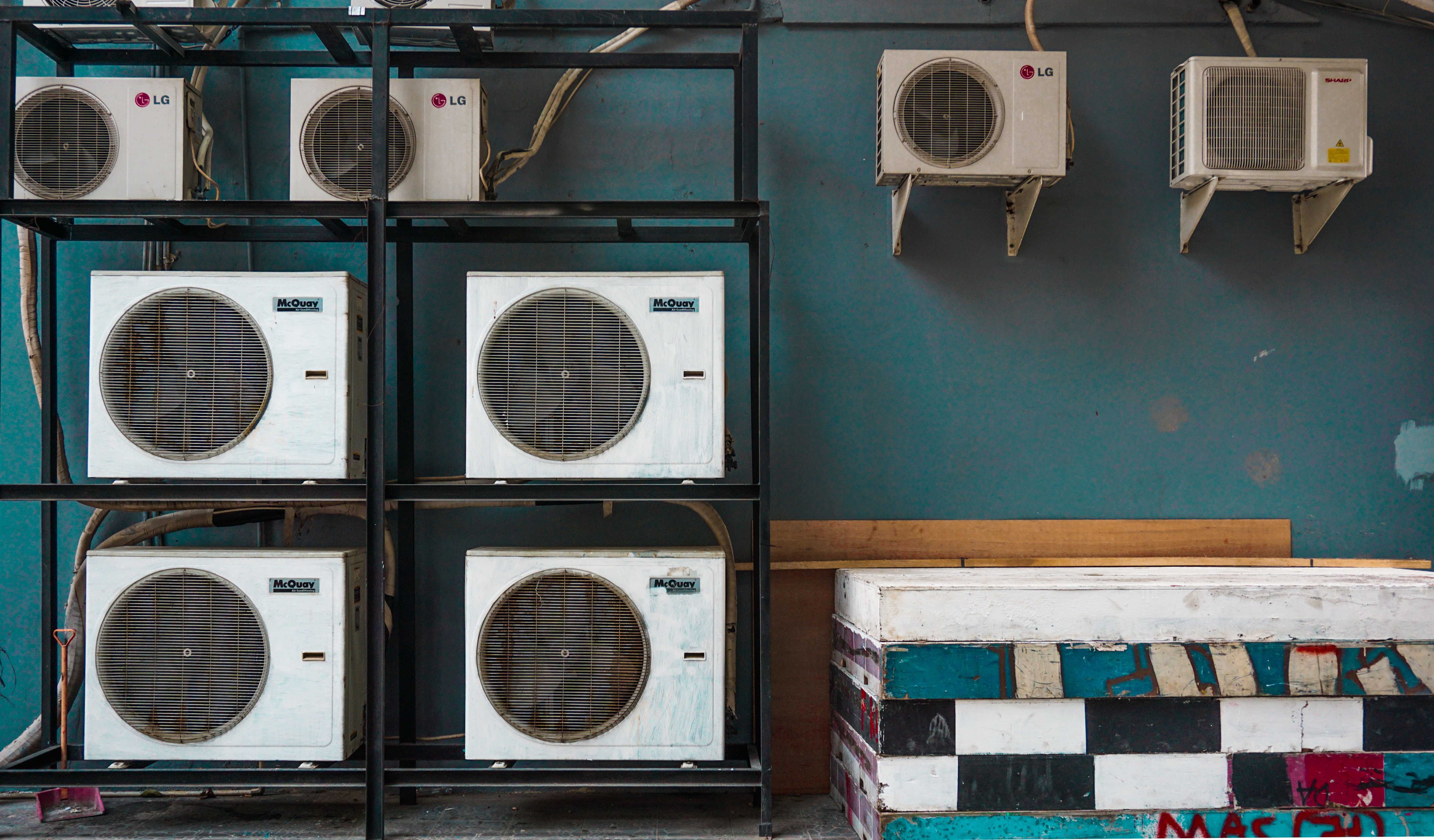 air conditioning units sitting on shelves