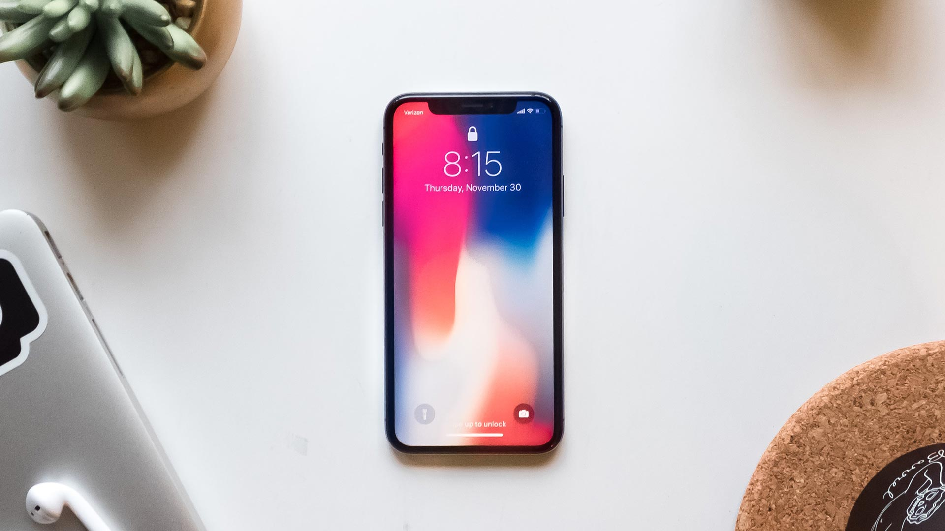 An iPhone sitting on a desk.