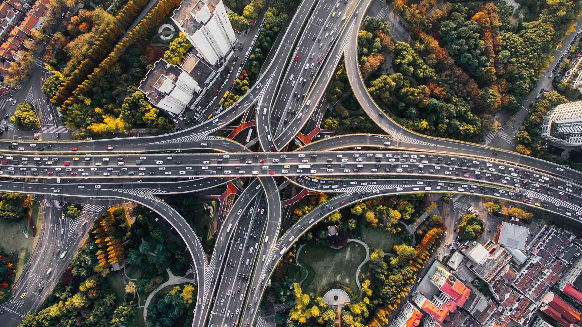 An arial view of a highway system, packed with cars.