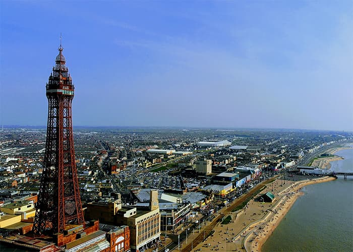 Ariel shot of Blackpool promenade with tower on left hand side