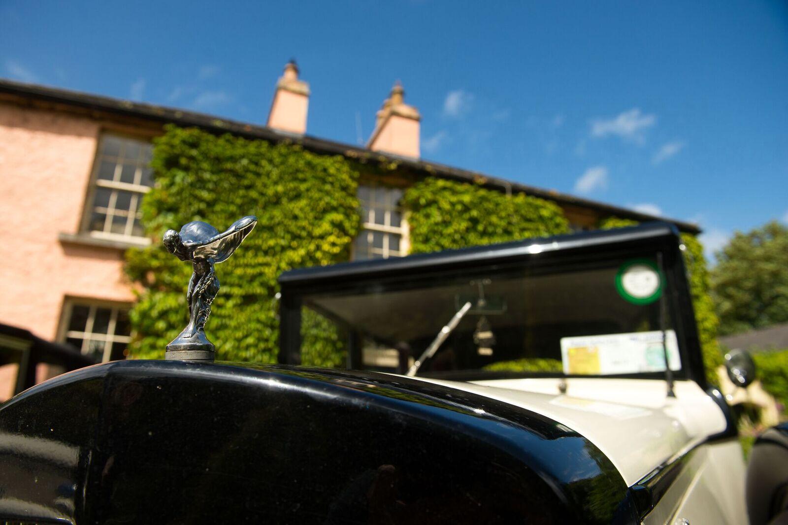 Arrive via chauffeur driven vintage car