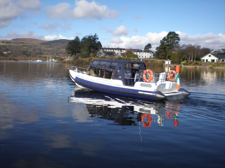 Enclosed power boat with seating up to 12pax