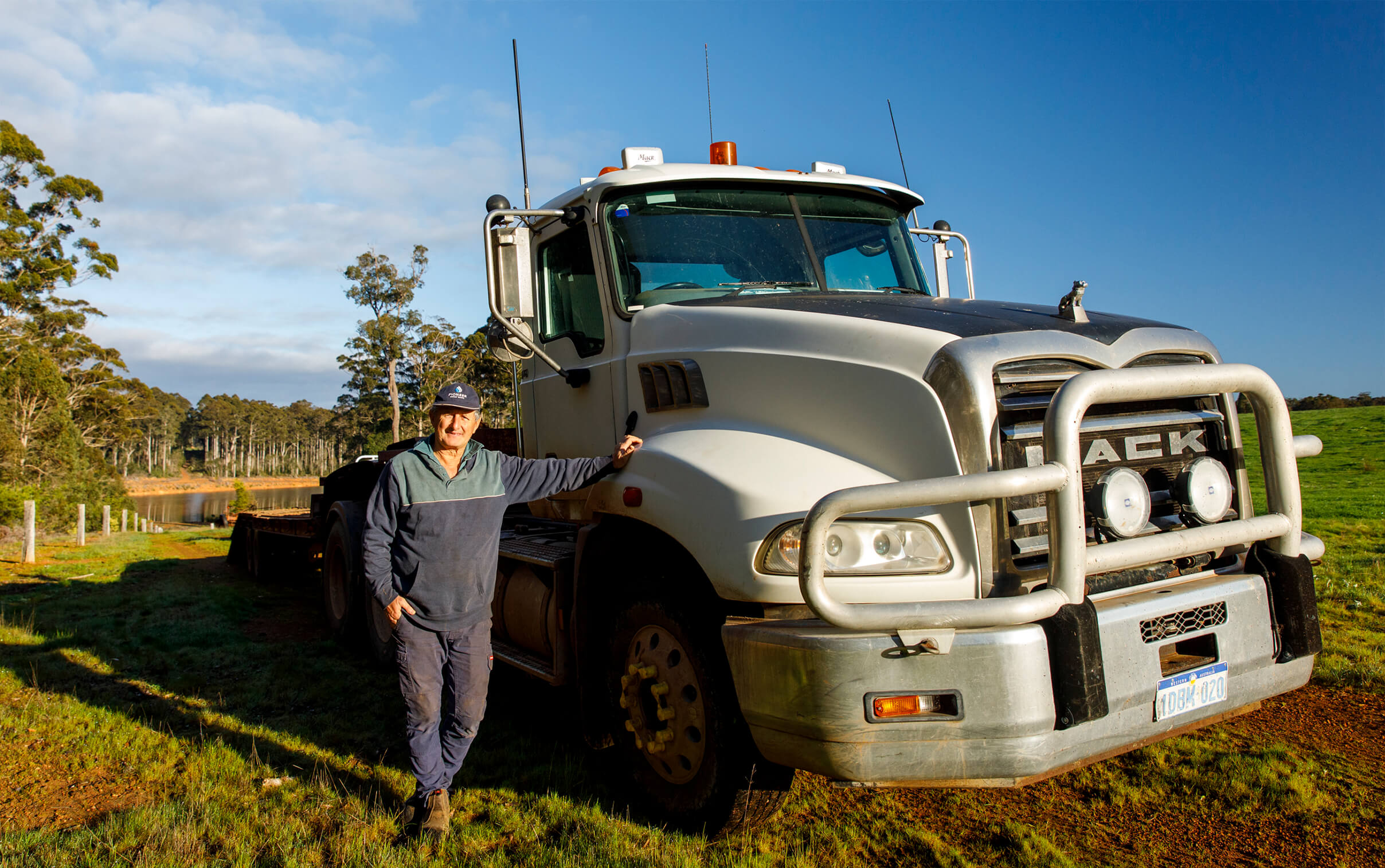 Kim Gandy leaning one arm against his truck on the Diamond Tree farm