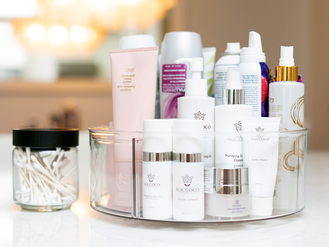 High-end skincare products for a nightly face cleaning regime organized on a lazy susan.