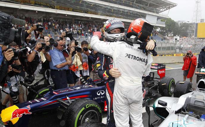 Michael Schumacher and Sebastian Vettel embrace after the 7 time World Champion's last race at Interlagos (Brazil, 2012)