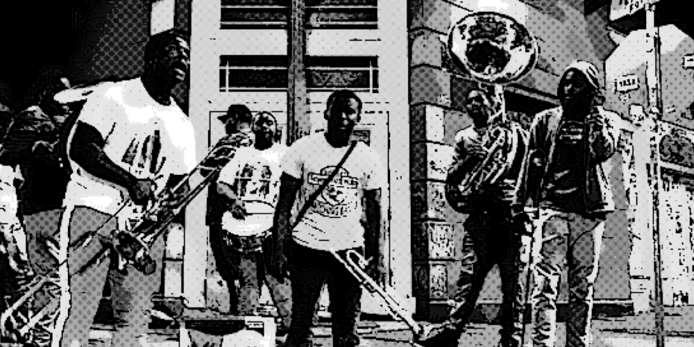 A brass band jams on a street corner