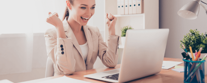 excited woman at computer