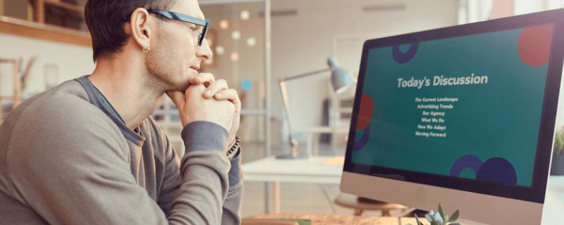 man watching virtual presentation