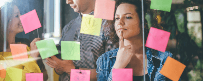 woman looking at sticky note wall