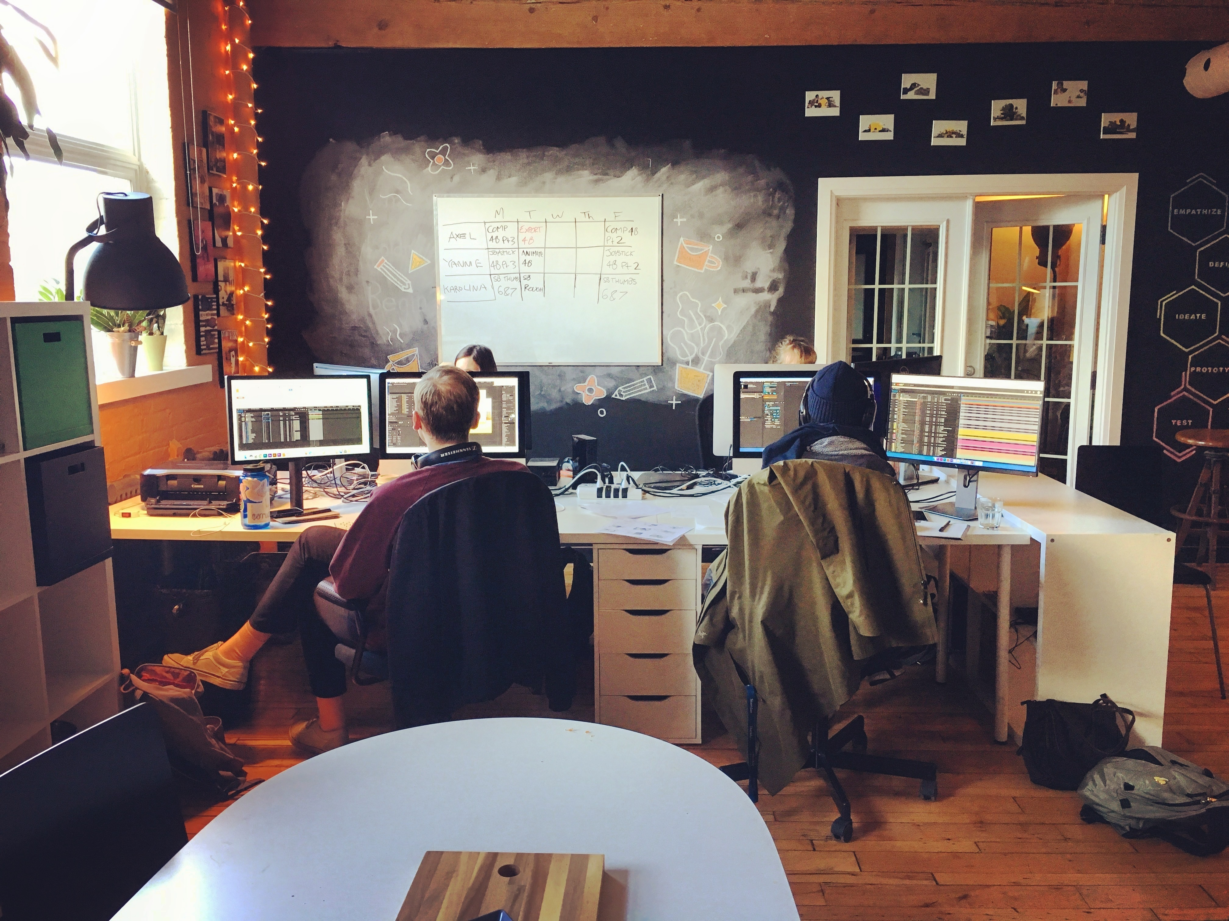 Sandbox team working at their desks in the office.