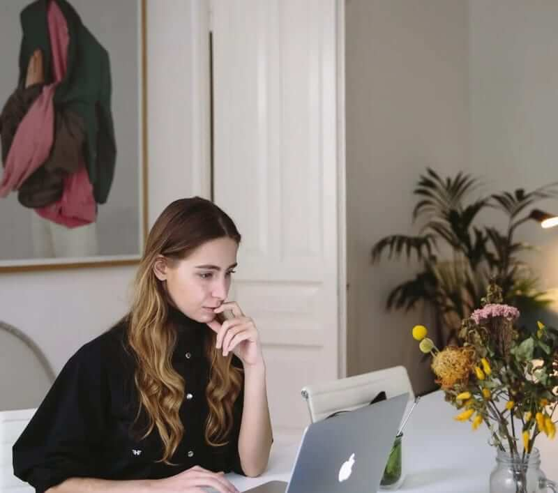 Young lady with a laptop in her room