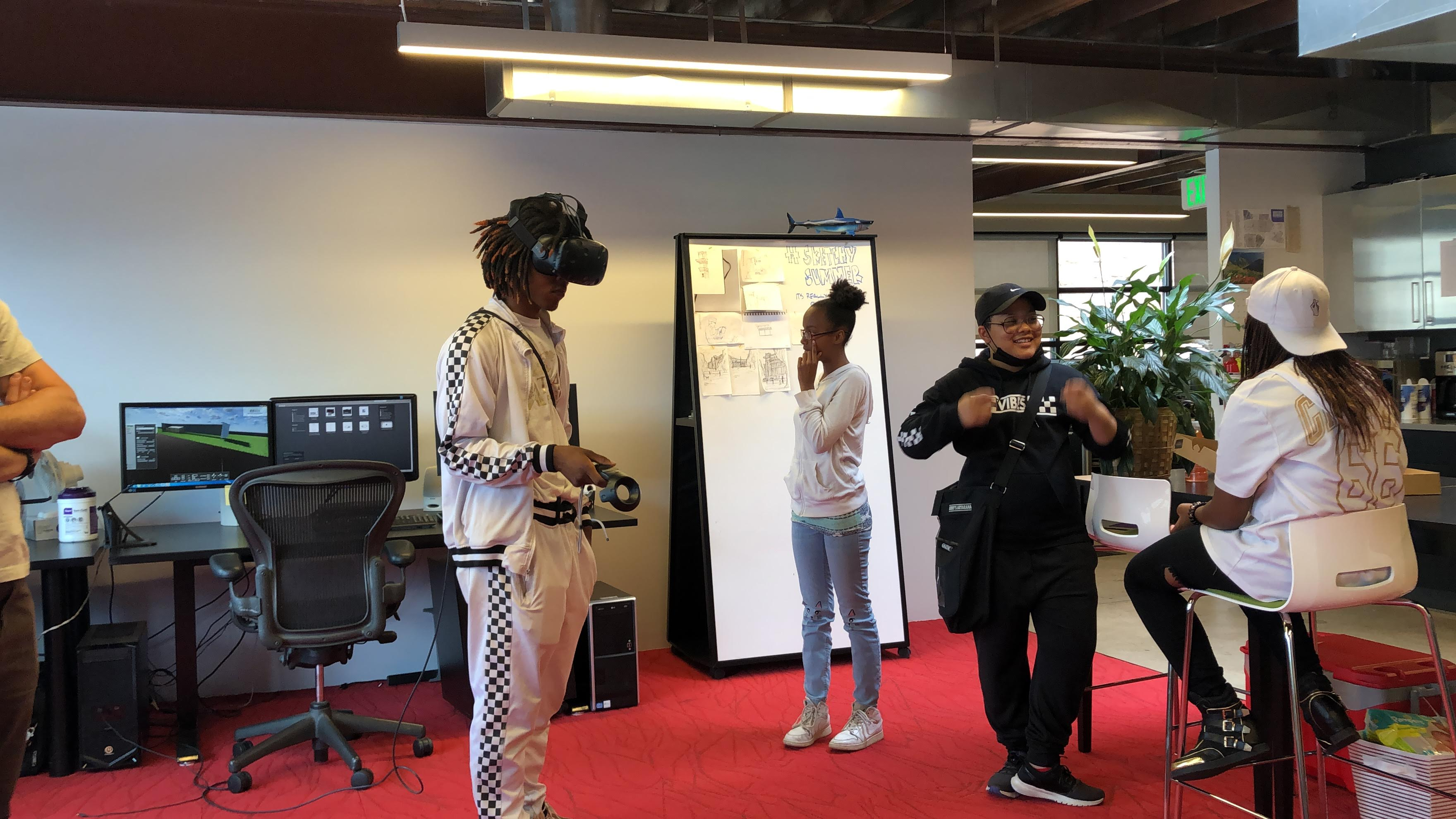 Person with a VR headset and others talking nearby
