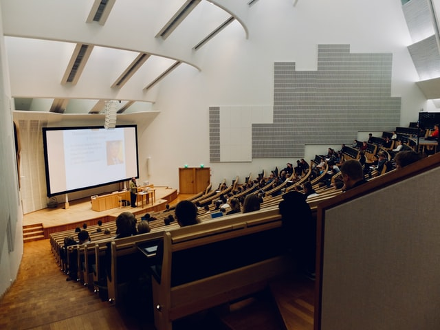 Students in a lecture hall satisfying medical school requirements for courses