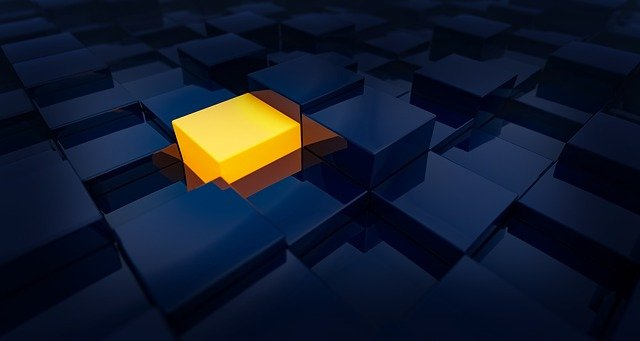 Variety of blue cubes with one yellow highlighted cube representing choosing a medical school.