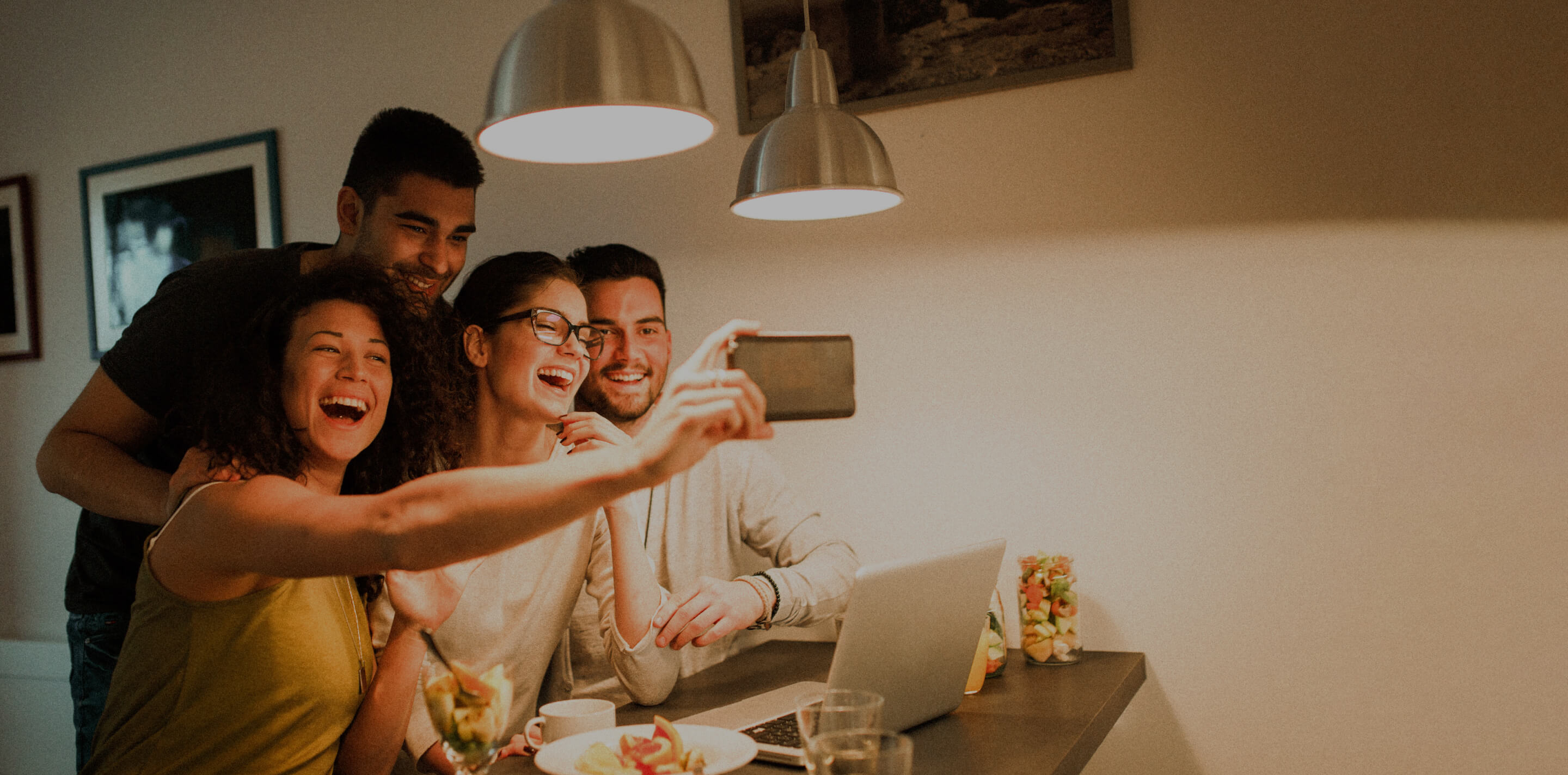 group of friends are taking on selfie in the kitchen